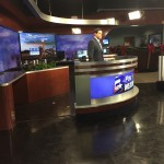 Watching the weather man do a spot for the upcoming newscast